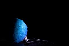 Blue Christmas Ball. Over black background Royalty Free Stock Photography