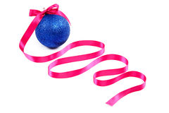 Blue Christmas ball and pink ribbon on white background. Royalty Free Stock Images