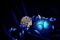 Blue Christmas ball with ribbon, fir cone Stock Photos