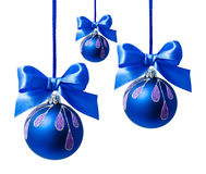 Blue christmas ball with ribbon isolated Royalty Free Stock Photos