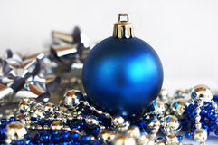 Blue christmas ball. With silver and blue decorations on white background Stock Image