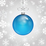 Blue Christmas ball on a silver ribbon Stock Image