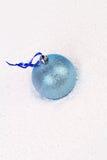 Blue christmas ball in snow. Royalty Free Stock Photos