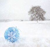 Blue Christmas ball on snowfield Royalty Free Stock Images