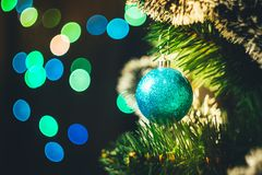 Blue Christmas ball on the spruce Christmas tree with multicolor royalty free stock photos