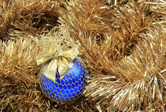 Blue christmas ball on a tinsel Stock Photo