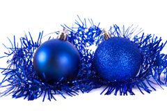 Blue christmas ball with tinsel. Isolated on white Royalty Free Stock Image