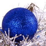 Blue christmas ball with tinsel. Isolated on white Royalty Free Stock Photo