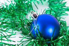 Blue christmas ball with tinsel. On white Stock Image