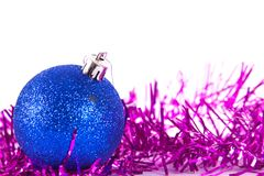 Blue christmas ball with tinsel. On white Royalty Free Stock Photos