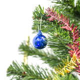 Blue christmas ball on tree isolated on white Royalty Free Stock Images