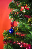 Blue christmas ball on tree on red background Royalty Free Stock Photos