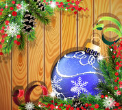 Blue Christmas ball on wooden background. Blue Christmas ball, cones, berries and fir tree branches on wooden background Stock Photos