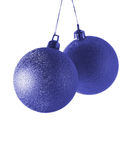 Blue christmas balls. Two deep blue christmas balls isolated over white background stock images