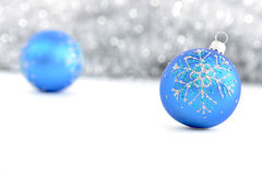 Blue Christmas balls. With blured grey lights background Royalty Free Stock Photos
