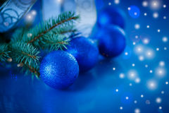 Blue Christmas balls. On blue background royalty free stock images