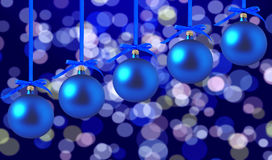 Blue Christmas balls with bows on bright holidays background Royalty Free Stock Images