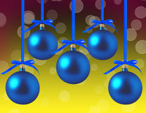 Blue Christmas balls with bows over bright Royalty Free Stock Image