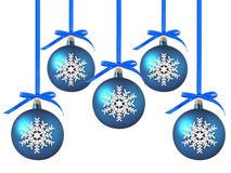 Blue Christmas balls with bows on white Stock Photography