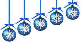 Blue Christmas balls with bows on white Royalty Free Stock Photos