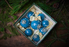 Blue Christmas balls in the boxes. Wooden background. Studio photography. Object shooting Stock Photo