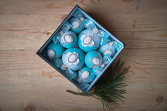 Blue Christmas balls with a cameo in the box, a wooden background. Royalty Free Stock Photos