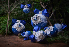 Blue Christmas balls on fir branches. Wooden background. Studio photography. Object shooting Royalty Free Stock Photos