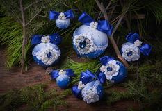 Blue Christmas balls on fir branches. Wooden background. Studio photography. Object shooting Stock Photo
