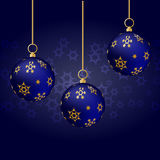 Blue christmas balls with gold ornament hanging on blue background Stock Photos