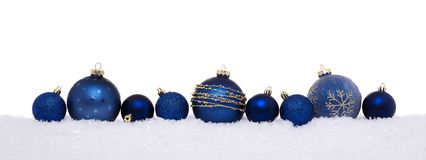 Blue christmas balls isolated on snow stock photos