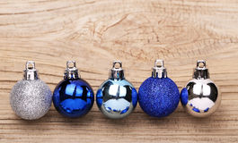 Blue Christmas Balls Over Wood Background Stock Image
