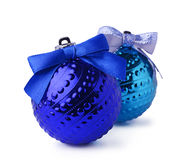 Blue Christmas balls with ribbon bows. Isolated on white background Stock Images