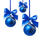 Blue christmas balls with ribbon isolated Stock Photos