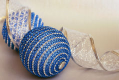 Blue Christmas balls and a ribbon Stock Image