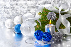 Blue christmas balls and silver candle Royalty Free Stock Photography