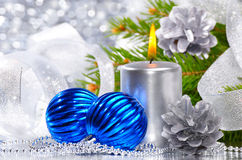 Blue christmas balls and silver candles Stock Photo