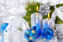 Blue christmas balls and silver candles Royalty Free Stock Photography