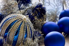 Blue Christmas balls with silver tinsel. Royalty Free Stock Photography