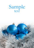 Blue Christmas balls and silver tinsel Stock Images