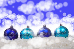 Blue christmas balls with snow. On a white background Stock Image