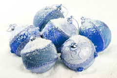 Blue christmas balls with snow Royalty Free Stock Image