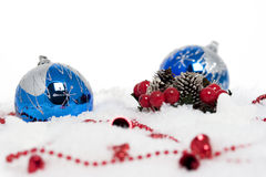 Blue christmas balls on snow Stock Photos
