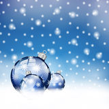 Blue christmas balls in snow. Background Royalty Free Stock Image