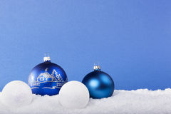 Blue Christmas balls in the snow Stock Photos