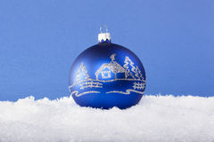 Blue Christmas balls in the snow Royalty Free Stock Photo