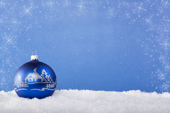Blue Christmas balls in the snow Royalty Free Stock Photography