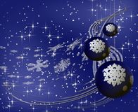 Blue Christmas balls on snowflake background. Blue Christmas tree ornament with white snowflakes and stardust Stock Photography