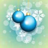 Blue christmas balls and snowflakes. New Year's background. Blue christmas balls and snowflakes on green background Stock Images