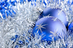 Blue christmas balls with tinsel Stock Images