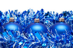 Blue christmas balls with tinsel isolated Royalty Free Stock Photos